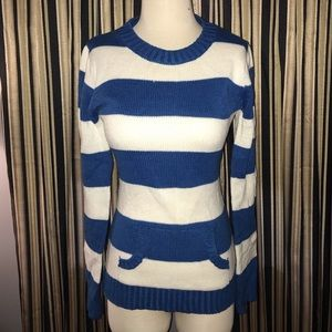 Blue and white striped sweater.
